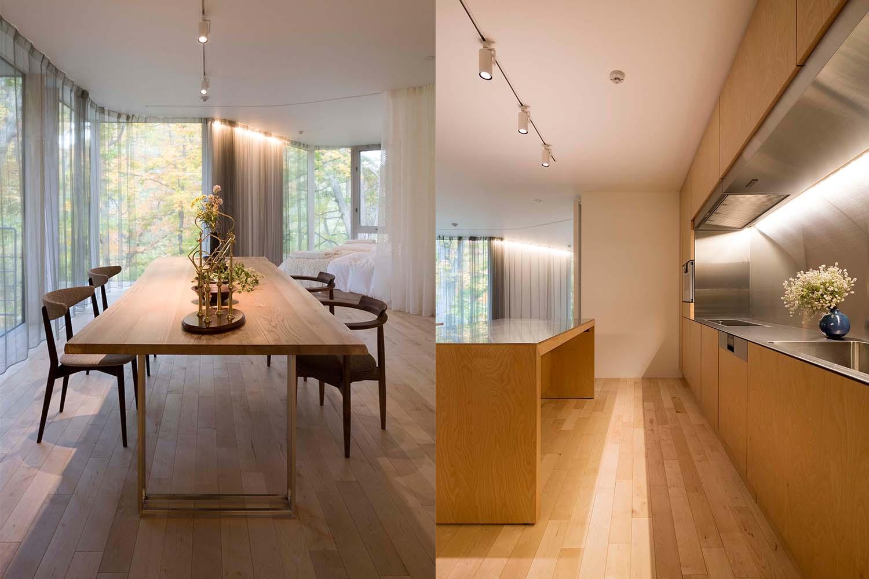 ニレ材の大きいダイニングテーブルとステンレスのキッチンがおしゃれなゲストハウス