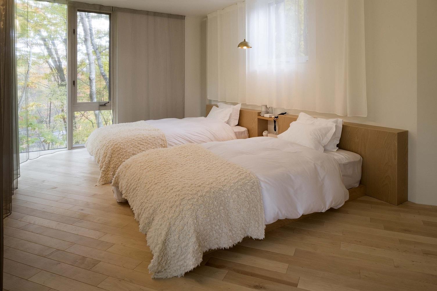 寝心地の良いベッドを納めたゲストハウス