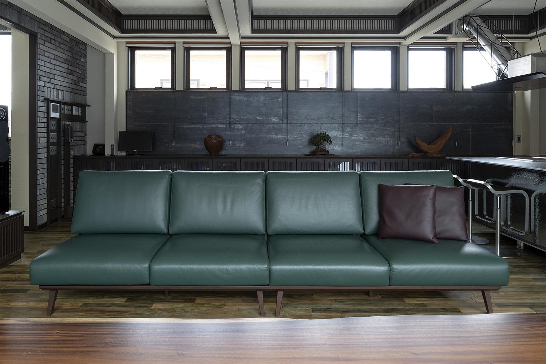 モダン空間に緑革のソファを置いた新築物件:澪工房